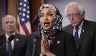 "Freshman Rep. Ilhan Omar, D-Minn., center, joins Rep. Peter Welch, D-Vt., left, and Sen. Bernie Sanders, I-Vt., as Sanders prepares to introduce new legislation to reduce what Americans pay for prescription drugs, especially brand-name drugs deemed ""excessively priced,"" during a news conference on Capitol Hill in Washington, Thursday, Jan. 10, 2019. (AP Photo/J. Scott Applewhite) ** FILE **"