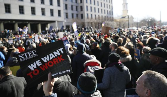 Union members and other federal employees rally to call for an end to the partial government shutdown, Thursday, Jan. 10, 2019 at AFL-CIO Headquarters in Washington.  (AP Photo/Pablo Martinez Monsivais)