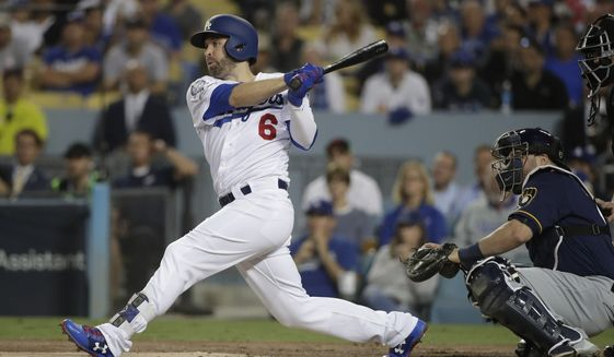 FILE - In this Oct. 16, 2018, file photo, Los Angeles Dodgers' Brian Dozier hits an RBI single during the first inning of Game 4 of the National League Championship Series baseball game against the Milwaukee Brewers, in Los Angeles. A person familiar with the negotiations tells The Associated Press that free-agent second baseman Brian Dozier and the Washington Nationals have agreed to a $9 million, one-year contract, subject to the successful completion of a physical exam.  The person confirmed the deal on condition of anonymity Thursday, Jan. 10, 2019, because neither the club nor player had announced anything. (AP Photo/Jae Hong, File)