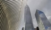 Parts of the Oculus, left, One World Trade Center, center, and 7 World Trade Center are seen from street level, Wednesday, Jan. 9, 2019, in New York. (AP Photo/Kathy Willens)