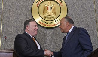 U.S. Secretary of State Mike Pompeo, left, shakes hands with Egyptian Foreign Minister Sameh Shoukry after holding a press conference, at the ministry of foreign affairs in Cairo, Egypt, Thursday, Jan. 10, 2019. Pompeo is in Cairo for talks with Egyptian leaders as he continues a nine-nation Middle East tour aimed at reassuring America's Arab partners that the Trump administration is not walking away from the region. (Andrew Caballero-Reynolds/Pool Photo via AP)