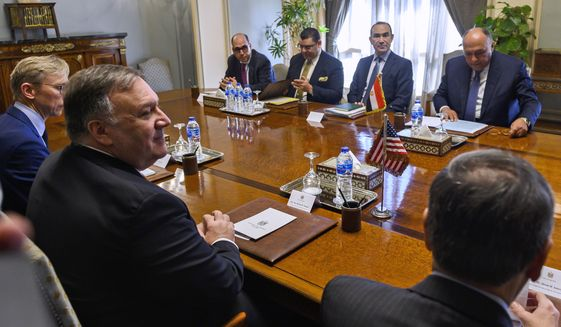 U.S. Secretary of State Mike Pompeo, second left, meets Egyptian Foreign Minister Sameh Shoukry, second right, and their delegations, at the ministry of foreign affairs in Cairo, Egypt, Thursday, Jan. 10, 2019. Pompeo is in Cairo for talks with Egyptian leaders as he continues a nine-nation Middle East tour aimed at reassuring America's Arab partners that the Trump administration is not walking away from the region. (Andrew Caballero-Reynolds/Pool Photo via AP)