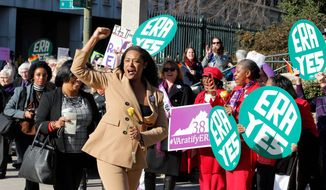 Delegate Jennifer Carroll Foy, D-Prince William, cheers on Equal Rights Amendment demonstrators outside the Capitol in Richmond, Va., Wednesday, Jan. 9, 2019. (AP Photo/Steve Helber)
