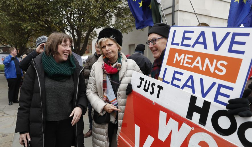 British conservative lawmaker Anna Soubry, center, who campaigned to remain in the European Union during referendum debates, reacts with pro-Brexit protesters outside parliament in London, Thursday, Jan. 10, 2019. Soubry was verbally confronted by Brexit campaigners on Monday outside parliament. Prime Minister Theresa May's proposed Brexit deal seems widely disliked by both pro-Europe and pro-Brexit politicians, threatening the exit agreement and future relations with EU. (AP Photo/Alastair Grant)