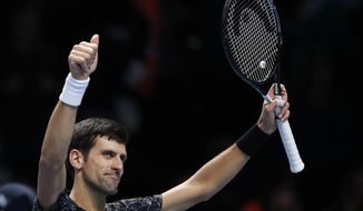 FILE - In this Wednesday, Nov. 14, 2018, file photo, Novak Djokovic of Serbia celebrates after defeating Alexander Zverev of Germany in the ATP World Tour Finals men's singles tennis match at O2 arena in London. Djokovic is one of the men to keep an eye on at the Australian Open, Jan. 14-27, 2019. (AP Photo/Alastair Grant, File)