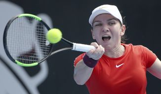 FILE - In this Jan. 9, 2019, file photo, Simona Halep of Romania hits a forehand to Ash Barty of Australia during their women's singles match at the Sydney International tennis tournament in Sydney, Australia. Halep will be competing in the Australian Open that runs Jan. 14-27, 2019. (AP Photo/Rick Rycroft, File)