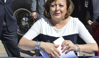 "FILE - In this March 7, 2018 file photo, then New Mexico Republican Gov. Susana Martinez is shown after signing the state's budget in Albuquerque, N.M. Martinez, who left office on Jan. 1, 2019, is defending President Donald Trump's call for a border wall and says ""it's disgusting"" not to call the situation on the U.S. Mexico-border a crisis. (AP Photo/ Russell Contreras, File)"