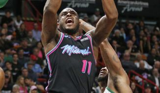Miami Heat guard Dion Waiters (11) goes up against Boston Celtics guard Marcus Smart (36) during the first half of an NBA basketball game, Thursday, Jan. 10, 2019, in Miami. (AP Photo/Joel Auerbach)