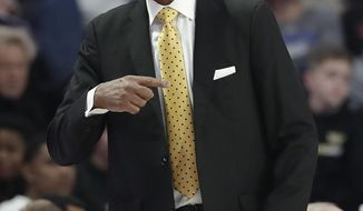 Wake Forest coach Danny Manning directs his team against Duke during the first half of an NCAA college basketball game in Winston-Salem, N.C., Tuesday, Jan. 8, 2019. (AP Photo/Chuck Burton)