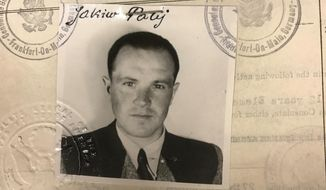 FILE - This 1949 photo provided by the U.S. Department of Justice shows a U.S. visa photo of Jakiw Palij, a former Nazi concentration camp guard who has been living in the Queens borough of New York. German media report that Jakiw Palij, a former Nazi concentration camp guard who spent decades leading an unassuming life in New York City until his past was revealed, has died. The Frankfurter Allgemeine Zeitung and Westfaelische Nachrichten newspapers quoted German officials on Thursday confirming that Palij, who was deported to Germany in August, died in a care home in the town of Ahlen. He was 95. (US Department of Justice via AP, file)