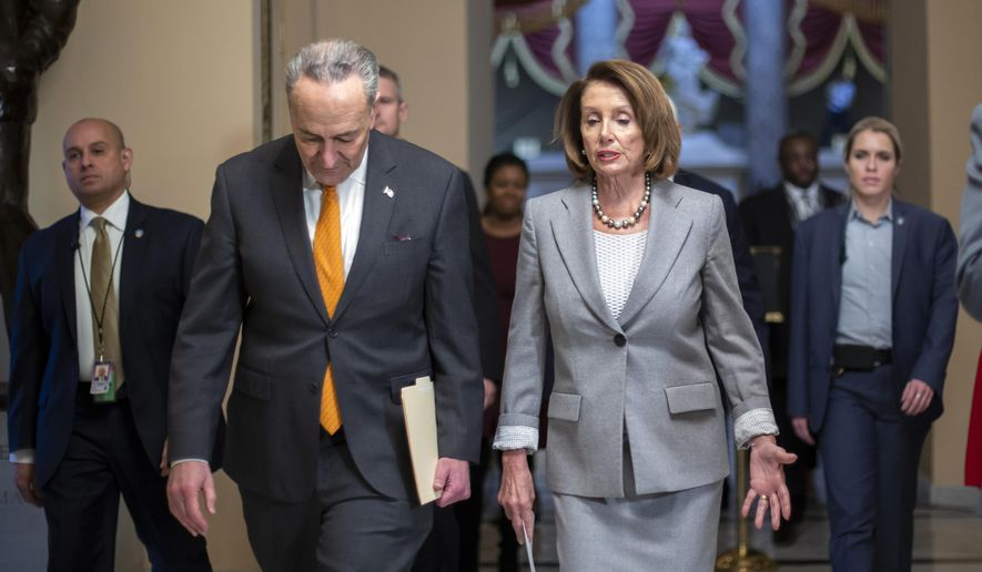 Speaker of the House Nancy Pelosi, D-Calif., and Senate Minority Leader Chuck Schumer, D-N.Y., left, walk to meet with furloughed federal workers and discuss the impact on families from the partial government shutdown amid President Donald Trump's demands for funding a U.S.-Mexico border wall, on Capitol Hill in Washington, Wednesday, Jan. 9, 2019. (AP Photo/J. Scott Applewhite)