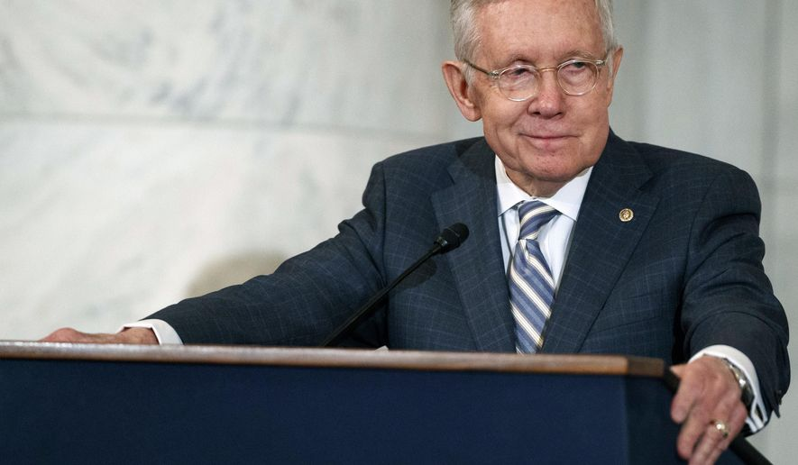 FILE - In this Dec. 8, 2016 file photo then Sen. Harry Reid, D-Nev., speaks during a ceremony on Capitol Hill in Washington. Reid said Thursday, Jan. 10, 2019,  he thinks President Donald Trump has no conscience and he'd like to see Utah Sen. Mitt Romney run against Trump in 2020 for the GOP nomination for president. The 79-year-old Democrat, who served as Senate Majority Leader, said in a radio interview with KNPR in Nevada that the partial government shutdown over Trump's push for a U.S.-Mexico border wall is an example of Trump's behavior.(AP Photo/Evan Vucci, File)