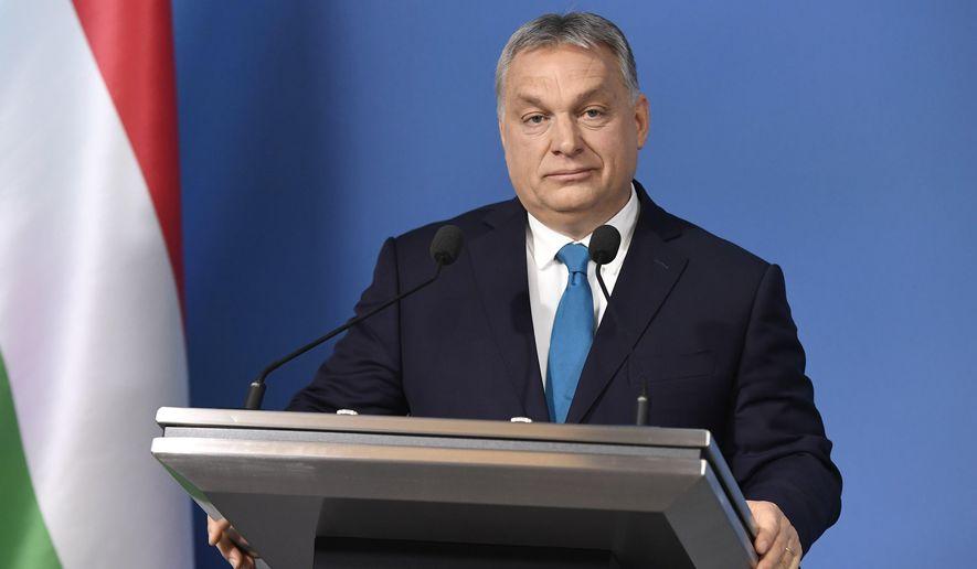 Hungarian Prime Minister Viktor Orban addresses the media during an international press conference in the Cabinet Office of the Prime Minister in Budapest, Hungary, Thursday, Jan. 10, 2019. (Szilard Koszticsak/MTI via AP)