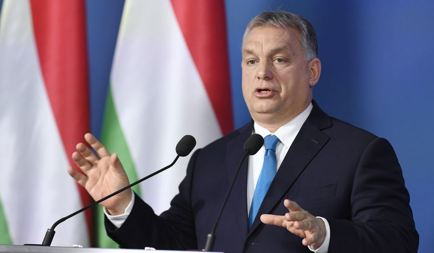 Hungarian Prime Minister Viktor Orban addresses the media during an international press conference in the Cabinet Office of the Prime Minister in Budapest, Hungary, Thursday, Jan. 10, 2019. (Szilard Koszticsak/MTI via AP)
