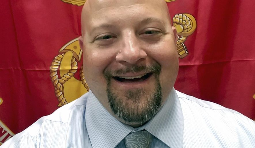 This undated photo provided by Travis Stein, shows Stein, a former inspector with the Iowa Occupational Safety and Health Administration. Stein and fellow inspector Jason Garmoe were fired on Tuesday, Jan. 8, 2019, in what they're calling an act of retaliation for blowing the whistle on a hostile environment inside the agency. (Travis Stein via AP)