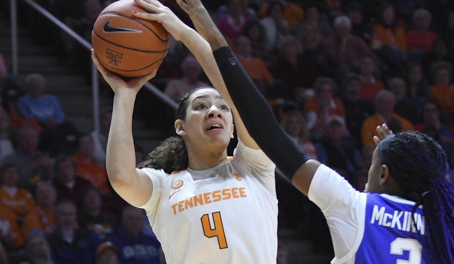 Tennessee forward Mimi Collins (4) shoots next to Kentucky forward Keke McKinney (3) during the first half of an NCAA college basketball game Thursday, Jan. 10, 2019, in Knoxville, Tenn. (Joy Kimbrough/The Daily Times via AP) **FILE**
