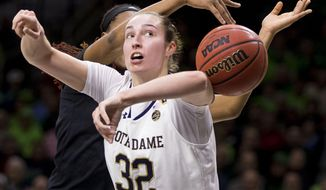 Notre Dame's Jessica Shepard (32) has the ball knocked away from behind by Louisville's Bionca Dunham during the first half of an NCAA college basketball game Thursday, Jan. 10, 2019, in South Bend, Ind. (AP Photo/Robert Franklin)