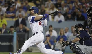 FILE - In this Oct. 16, 2018, file photo, Los Angeles Dodgers' Brian Dozier hits an RBI single during the first inning of Game 4 of the National League Championship Series baseball game against the Milwaukee Brewers, in Los Angeles. A person familiar with the negotiations tells The Associated Press that free-agent second baseman Brian Dozier and the Washington Nationals have agreed to a $9 million, one-year contract, subject to the successful completion of a physical exam.  The person confirmed the deal on condition of anonymity Thursday, Jan. 10, 2019, because neither the club nor player had announced anything. (AP Photo/Jae Hong, File) **FILE**