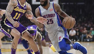 Detroit Pistons guard Reggie Bullock, right, tries to drive past Los Angeles Lakers forward Michael Beasley during the first half of an NBA basketball game Wednesday, Jan. 9, 2019, in Los Angeles. (AP Photo/Mark J. Terrill)