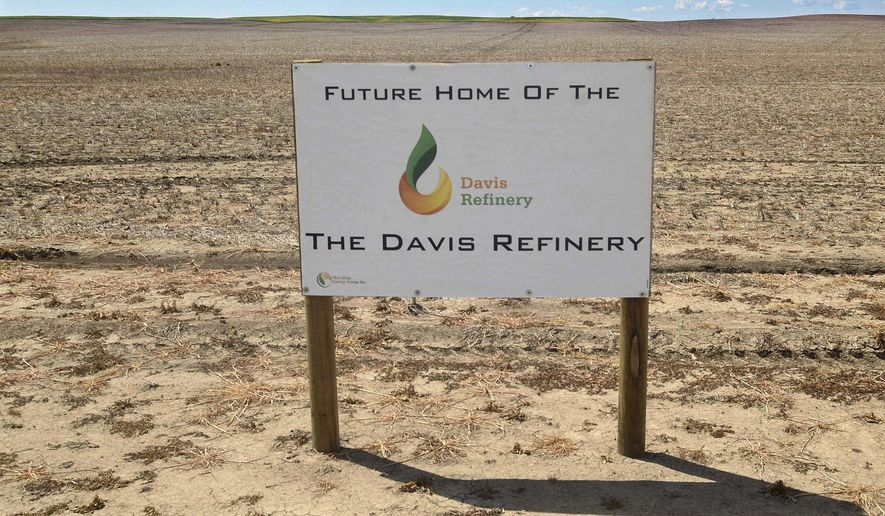 FILE - This July 19, 2018, file photo shows a sign on property, near southwest Belfield, N.D., for the future home of the Davis Refinery near Theodore Roosevelt National Park. An administrative law judge in North Dakota is recommending that state officials issue a water permit for an oil refinery being developed near Theodore Roosevelt National Park. Area landowners challenged a proposed permit that would allow the Davis Refinery to draw water from an underwater aquifer. (Tom Stromme/The Bismarck Tribune via AP, File)