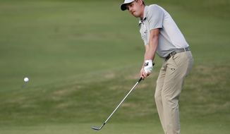 Andrew Putnam hits onto the 10th green during the first round of the Sony Open PGA Tour golf event, Thursday, Jan. 10, 2019, at the Waialae Country Club in Honolulu, Hawaii. (AP Photo/Matt York)