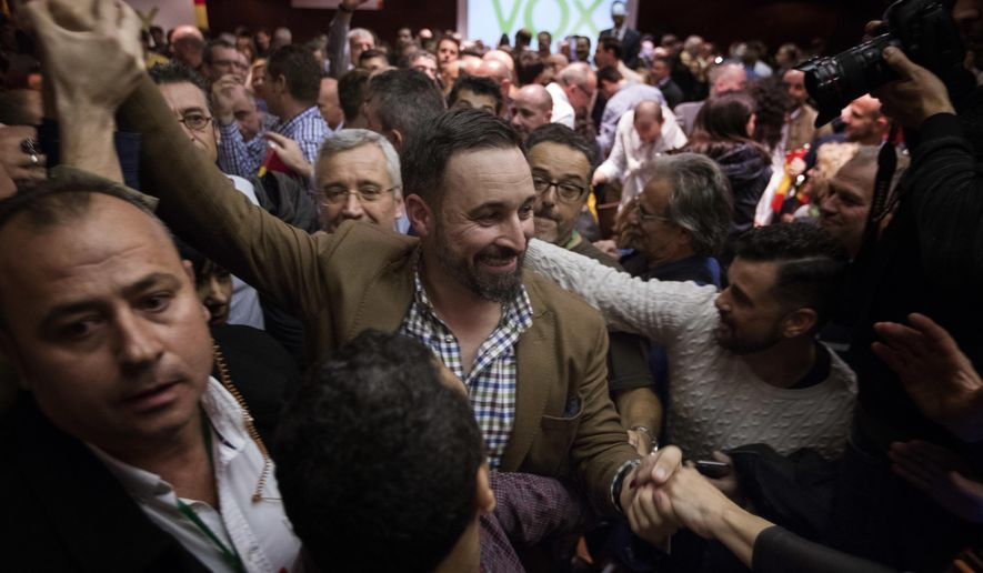 FILE - In this Wednesday, Nov. 14, 2018 file photo, Spain's far-right Vox Party President Santiago Abascal, arrives at a party rally in Murcia, Spain. Spain's new far-right Vox party is edging toward the political mainstream, dropping its more extremist positions to help form a regional government in Andalucia, according to a new political alliance announced late Wednesday Jan. 9, 2019. (AP Photo/Emilio Morenatti, FILE)