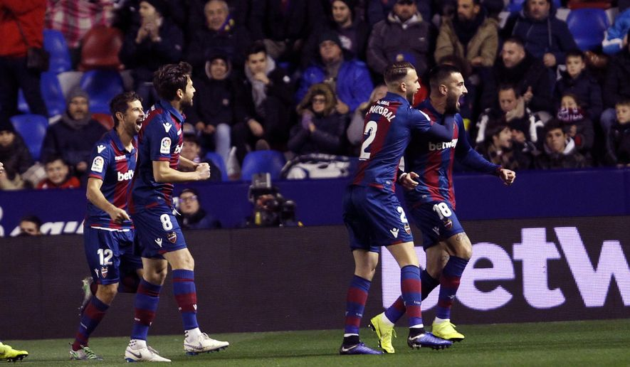 Levante defender Erick Cabaco, right , celebrates after scoring against Barcelona during the la Copa del Rey round of 16 first leg soccer match between Levante and Barcelona at the Ciutat de Valencia stadium in Valencia, Spain, Thursday Jan. 10, 2019. (AP Photo/Alberto Saiz)