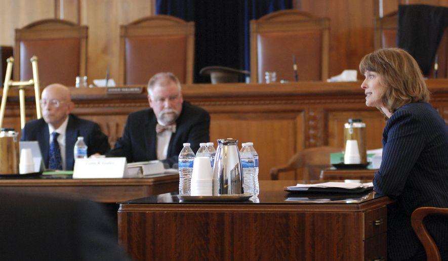 A nominating commission interviews Supreme Court candidate Shannon Bacon, right, an Albuquerque-based district judge, at the Supreme Court in Santa Fe, N.M., Thursday, Jan. 10, 2018 The commission is delivering its recommendations for replacing two recently retired justices to Democratic Gov. Michelle Lujan Grisham, who will have 30 days to make her appointments. (AP Photo/Morgan Lee)