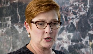 Australia's Foreign Minister Marise Payne gestures as she answers a journalist's question in Bangkok, Thailand, Thursday, Jan. 10, 2019. Visiting Thailand on Thursday, Payne praised her hosts for their handling of the case of the young Saudi woman fleeing her family to seek asylum in Australia, but said she also reminded them of continuing concern about a Bahraini soccer player granted asylum in Australia who is in Thai detention. (AP Photo/Gemunu Amarasinghe)