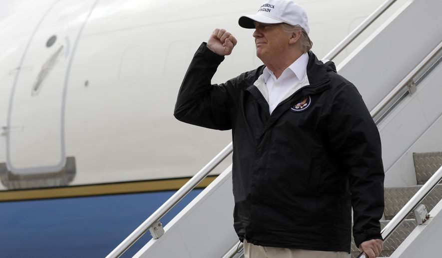 President Donald Trump gestures after arriving at McAllen International Airport for a visit to the southern border, Thursday, Jan. 10, 2019, in McAllen, Texas. (AP Photo/ Evan Vucci)