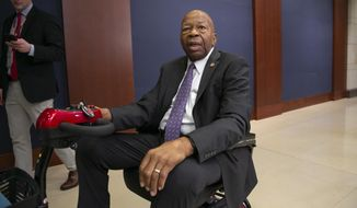 Rep. Elijah Cummings, D-Md., chairman of the House Committee on Oversight and Reform, speaks to reporters after announcement that President Donald Trump's former lawyer, Michael Cohen, will testify publicly before Rep. Cummings' panel next month, on Capitol Hill in Washington, Thursday, Jan. 10, 2019. Cohen's testimony before the House Oversight and Reform Committee will be the first major public hearing for Democrats, who have promised greater scrutiny of Trump. (AP Photo/J. Scott Applewhite) **FILE**