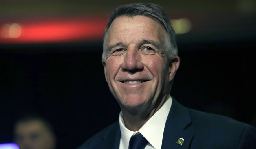 In this Nov. 6, 2018, file photo, Republican Vermont Gov. Phil Scott smiles during an election night rally party in Burlington, Vt. (AP Photo/Charles Krupa, File)