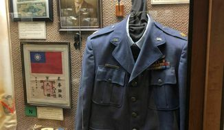 This undated photo provided by the Chennault Aviation and Military Museum in Monroe, La., shows an exhibit of artifacts from Maj. Richard Sherman, who flew 52 missions over China during World War II. Sherman was in the 11th Bomb Squadron of the Army's 14th Air Force under Gen. Claire Chennault, who nicknamed the 14th the Flying Tigers after the volunteer fighter group he had created while acting as a civilian advisor to nationalist China to defend that nation before the U.S. entered World War II. Sherman died Wednesday, Jan. 9, 2019, in Monroe. (Nell Calloway/Chennault Aviation and Military Museum via AP) **FILE**