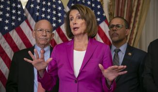 Speaker of the House Nancy Pelosi, D-Calif., flanked by Rep. Peter DeFazio, D-Ore., left, and Rep. Anthony Brown, D-Md., talks to reporters after signing a House-passed a bill requiring that all government workers receive retroactive pay after the partial shutdown ends, at the Capitol in Washington, Friday, Jan. 11, 2019. (AP Photo/J. Scott Applewhite) **FILE**