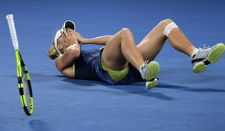 FILE - In this Jan. 27, 2018, file photo, Denmark's Caroline Wozniacki celebrates after defeating Romania's Simona Halep in the women's singles final at the Australian Open tennis championships in Melbourne, Australia. Wozniacki will be defending a Slam title for the first time after winning in Melbourne a year ago. (AP Photo/Andy Brownbill, File)
