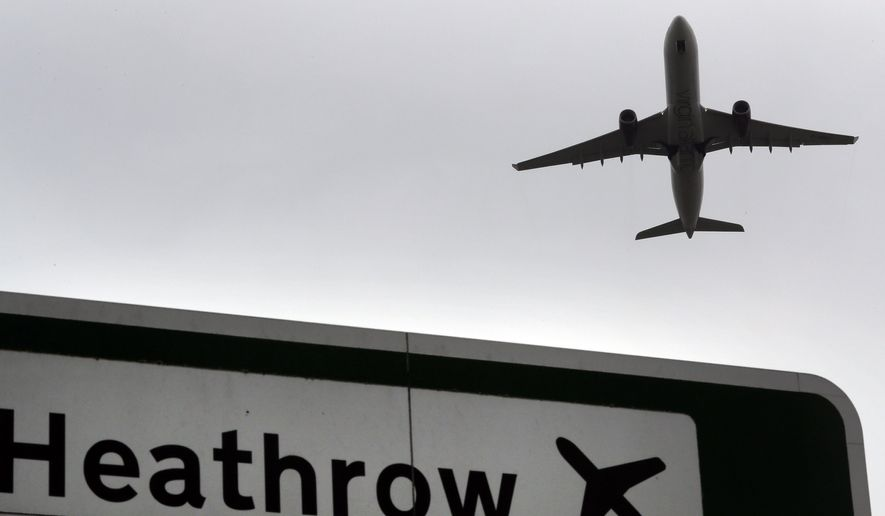 FILE - In this file photo dated Tuesday, June 5, 2018, a plane takes off over a road sign near Heathrow Airport in London. British lawmakers are set to vote Monday June 25, 2018, on whether to expand Europe's biggest airport, Heathrow. Disruptions to air travel are possible if Britain leaves the European Union in March without a deal, the head of the leading association for airlines around the world warned Thursday, Jan. 10, 2019. (AP Photo/Kirsty Wigglesworth, file)