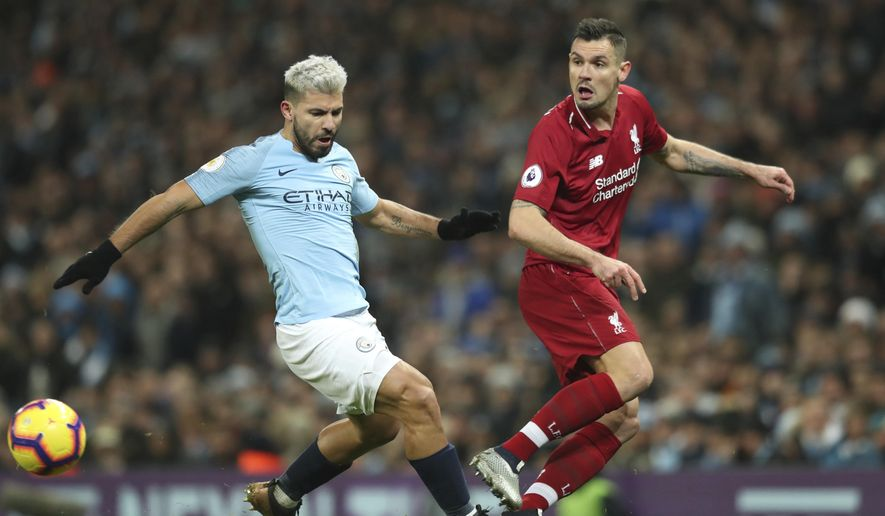 Liverpool's Dejan Lovren, right gets the ball away from Manchester City's Sergio Aguero during their English Premier League soccer match between Manchester City and Liverpool at the Ethiad stadium, Manchester England, Thursday, Jan. 3, 2019. (AP Photo/Jon Super)