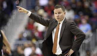 Washington Wizards coach Scott Brooks points during the second half of an NBA basketball game against the Milwaukee Bucks, Friday, Jan. 11, 2019, in Washington. The Wizards won 113-106. (AP Photo/Nick Wass) ** FILE **