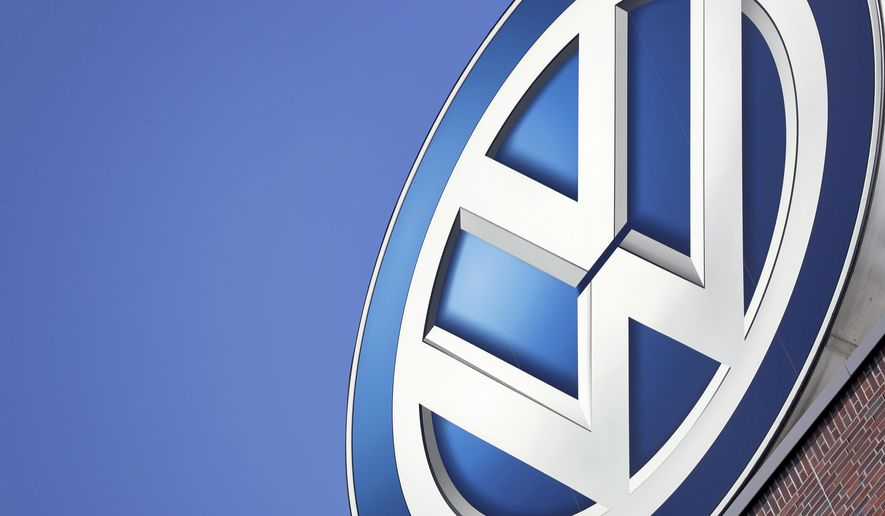 FILE - In this Wednesday, Aug. 1, 2018, file photo, a logo of the brand Volkswagen on top of a company building is pictured prior to a Volkswagen stock company press conference in Wolfsburg. (AP Photo/Michael Sohn)