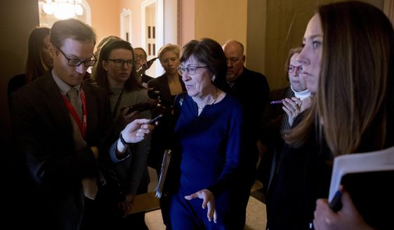 Sen. Susan Collins, R-Maine, speaks to reporters as she walks into the office of Senate Majority Leader Mitch McConnell of Ky. for a meeting with Senate Republicans on Capitol Hill in Washington, Thursday, Jan. 10, 2019. (AP Photo/Andrew Harnik)