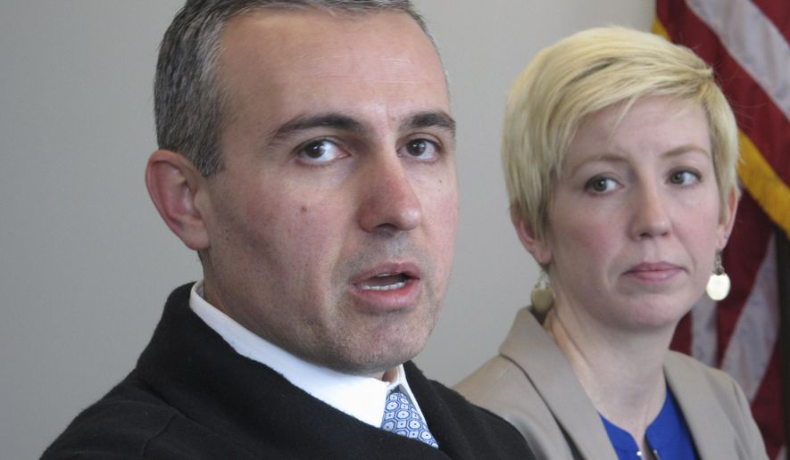 Dr. Eric Moradshahi, left, a federal psycholigst in Reno working without pay, and Brianna Bedard, wife of a U.S. Coast Guardsman working at Lake Tahoe without pay, told reporters in Reno Friday, Jan. 11, 2019, about the impact the partial government shutdown is having on their families. They were among 25 people who met with Sen. Catherine Cortez Masto about the shutdown in her Reno office. (AP Photo/Scott Sonner)