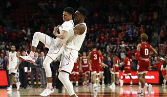 Maryland guard Anthony Cowan Jr., left, and forward Bruno Fernando, of Angola, celebrate after winning an NCAA college basketball game against Indiana, Friday, Jan. 11, 2019, in College Park, Md. (AP Photo/Patrick Semansky) ** FILE **