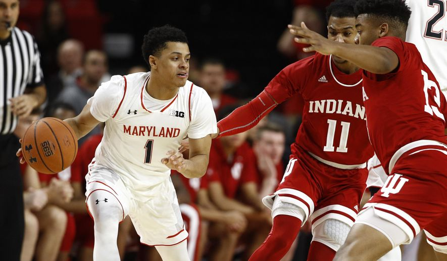 Maryland guard Anthony Cowan Jr., left, drives against Indiana guard Devonte Green (11) and forward Juwan Morgan in the first half of an NCAA college basketball game, Friday, Jan. 11, 2019, in College Park, Md. (AP Photo/Patrick Semansky)