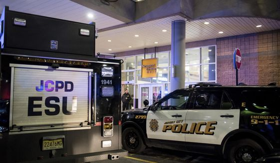 Police respond to a shooting at Newport Centre Mall in Jersey City, N.J., Friday, Jan. 11, 2019. (Reena Rose Sibayan/The Jersey Journal via AP)