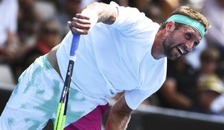 Tennys Sandgren of the U.S. plays a shot to Philipp Kohlschreiber of Germany during the semifinal match of the ASB Classic Mens tennis tournament in Auckland, New Zealand, Friday, Jan 11, 2019. (AP Photo/Chris Symes)