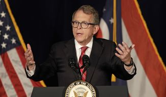 FILE - In this Oct. 31, 2018, file photo, Mike DeWine, Republican candidate for Ohio Governor, speaks at the Mansfield Lahm Regional Airport in Mansfield, Ohio. The inauguration of Gov.-elect DeWine will mark a shift away from volatility in a state buffeted in recent years between the shifting ambitions of an outspoken governor and the frequent outbursts of an unpredictable president. Even before taking office Monday, DeWine has moved through the transition process with a methodical calm. (AP Photo/Tony Dejak, File)