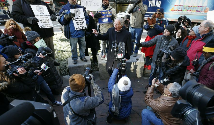 """U.S. Sen. Ed Markey, D-Mass., center, speaks during a rally with government workers and their supporters in Boston, Friday, Jan.11, 2019. Markey said President Donald Trump is using federal workers and their families as """"pawns"""" and """"hostages"""" in a political game. (AP Photo/Michael Dwyer)"""