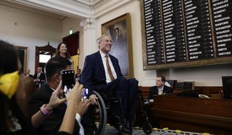Gov. Greg Abbott arrives to address the House members during the first day of the 86th Texas Legislative session, Tuesday, Jan. 8, 2019, in Austin, Texas. (AP Photo/Eric Gay)