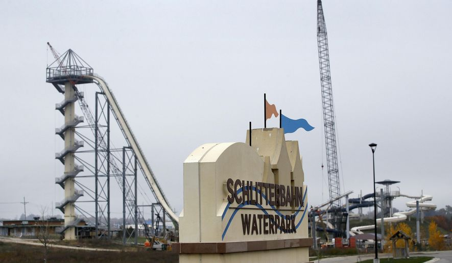 FILE - In this Oct. 30, 2018, file photo, crews dismantle the Verruckt waterslide at the Schlitterbahn water park in Kansas City, Kan. The waterslide, which was billed as the world's tallest, has not been used since a 10-year-old boy was decapitated more than two years ago on the ride. In an email Friday, Jan. 11, 2019, operators of the park aren't saying whether the attraction will open for the upcoming season. (AP Photo/Charlie Riedel, File)