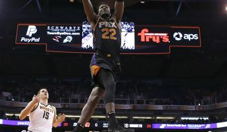 Phoenix Suns center Deandre Ayton (22) dunks against the Denver Nuggets in the second half during an NBA basketball game, Saturday, Jan. 12, 2019, in Phoenix.  (AP Photo/Rick Scuteri)